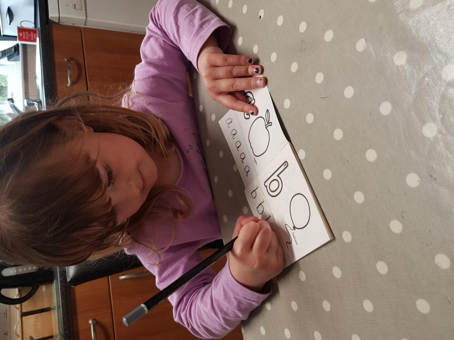 Concentrating on her letter formation