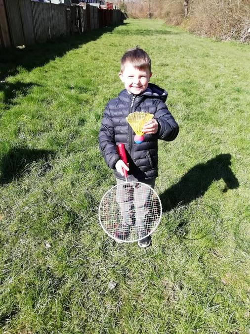 Playing badminton outside.