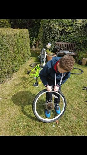 Ben learning life skills! (Fixing a tyre)