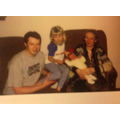 A picture of me and my grandma and dad with my brother - 2000