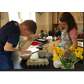 Kate cooking with her brother
