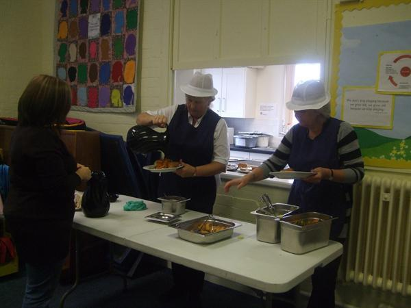 Midday Supervisors serving on Roast Dinner Day