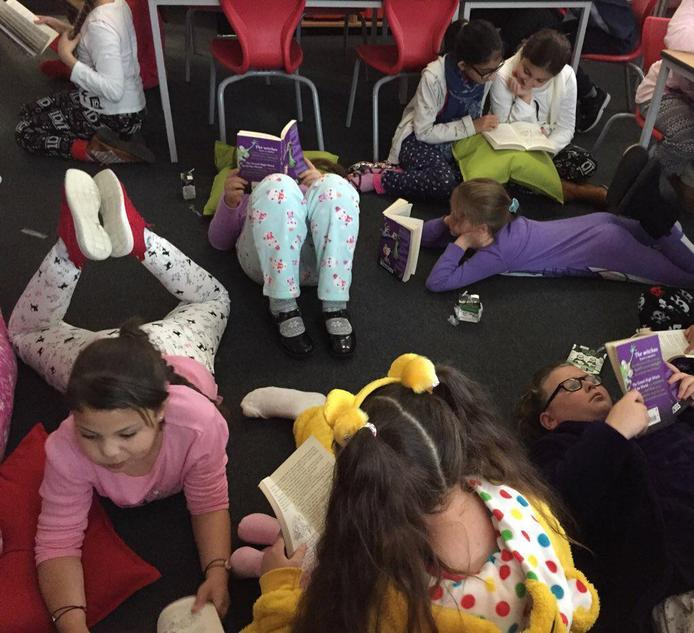 Enjoying a story during reading week.