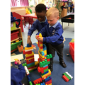 Danny and Rayyan work together to build a castle