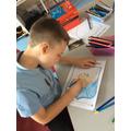 Joshua designing his shield