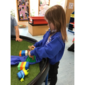 Rebecca used the props to act out the Three Billy Goats Gruff story