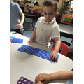 We explored making amounts with the numicon pieces.