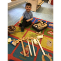 Noah made a cow using the loose parts