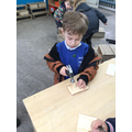 Mason was learning to use the hammer and nails