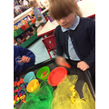 Ava-Lilly sorted the objects by colour.