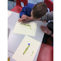 We painted caterpillars using our finger prints.