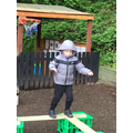 Braidon practiced his balancing walking around the obstacle course