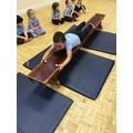Kuba shows good skills in pulling himself along the bench in P.E.