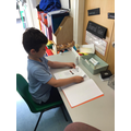 Selim proudly sticking in his Math's enhancement activity.