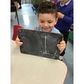 Noah practises his number writing