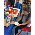 Evie decided to try adding a moving draw bridge to her castle model
