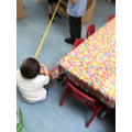 We enjoy exploring measuring with the tape measures.