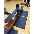 Rayyan shows good balancing skills as we move in different ways across the bench