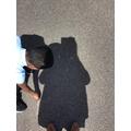Making shadows.