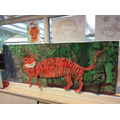 Today we painted our tiger for our jungle we used cotton buds to draw the stripes