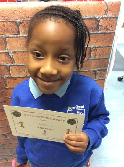 Week 3 - Jo Jo for writing a sentence about the 3 little pigs using her phonics.