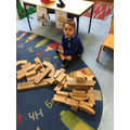 The children use their imagination when playing with the large wooden blocks