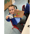 Connie shows good hammer skills when creating her picture using shapes