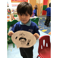 Eli uses great mark making skills to draw a picture of his mum