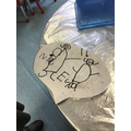 Nia drew and labelled a picture of her and her sister, sounding out her sister's name