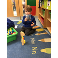 Ronnie-Jay made a castle using the wooden blocks and a picture for ideas.