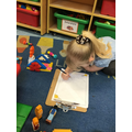 Scarlett drew a picture of the model she made.