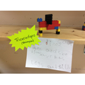 Dinosaur construction with Lego and label of a Triceratops.