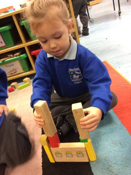 Kara built 'the town hall' using the bricks to build and balance.