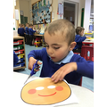 Viktor practised his cutting skills to make a Gingerbread man mask.