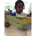 Humairah reading to Mrs Pirie.