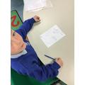Frankie working on his sketching skills.