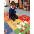 Learning about place value with dienes.