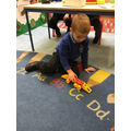 Dominic uses his imagination to make a shark train with the mobilo