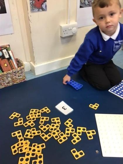 George did some super counting of the numicon pieces.