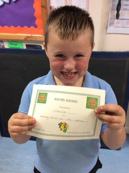 Week 5- Charlie for persevering and working hard on his addition.
