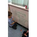 Practising number sentences.