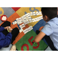 The boys creating words for each letter of the alphabet linked to their interests.