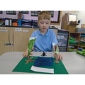 Connor made a jungle habitat. He added a spider in its web.