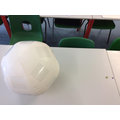 Modelling a comparison of the relative sizes of the Sun, Earth and moon.