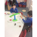 We practised weighing and measuring objects.