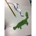 We made dinosaur play dough skeletons.