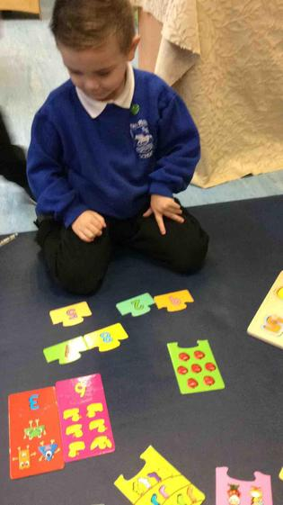 Charlie is super at recognising the numerals.