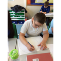 Learning to use a compass to compare the sun, Earth and moon