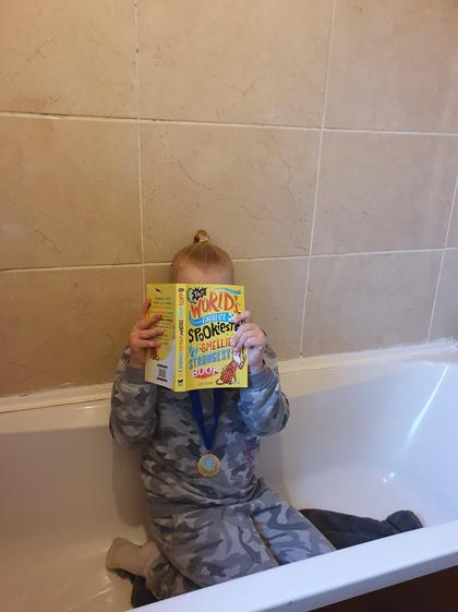 Grace reading in the bath