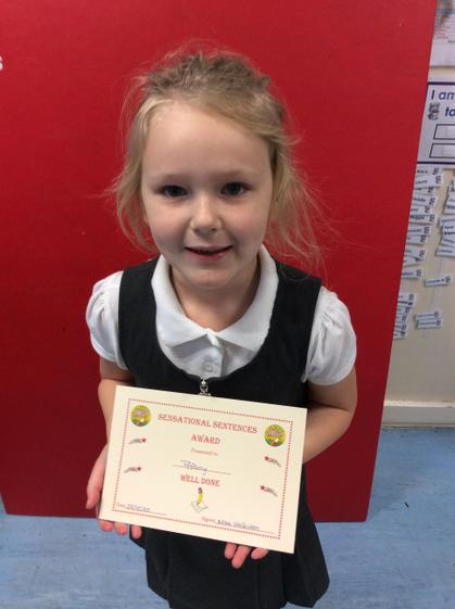 Week 7- Tiffany for using her phonics to write sentences independently.
